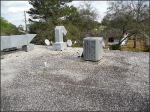 Gravel surfaced built-up roof system.